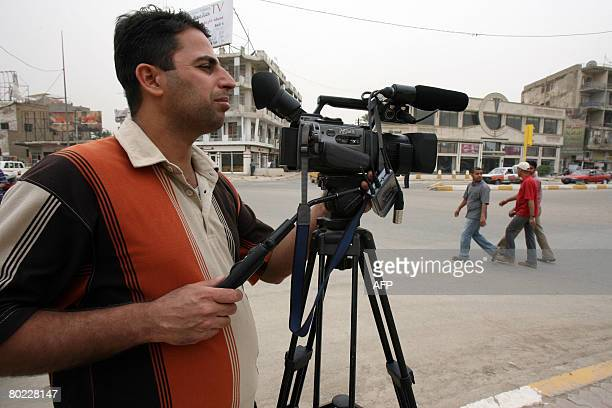 An Iraqi cameraman shoots with his camera in central Baghdad on March 11 2008 Freedom of the press flourished after Saddam Hussein's tight grip on...