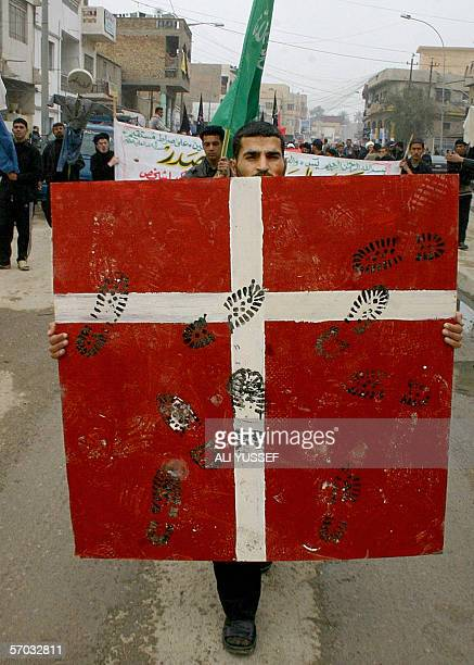 An Iraqi carries a placard symbolically indicating stamping of the Danish flag during a demonstration in the city of Baquba northeast of Baghdad 08...