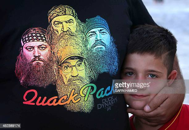 An Iraqi Christian child, and his family, that fled violence in the northern city of Mosul, arrive in the village of Qaraqush, about 30 kms southeast...