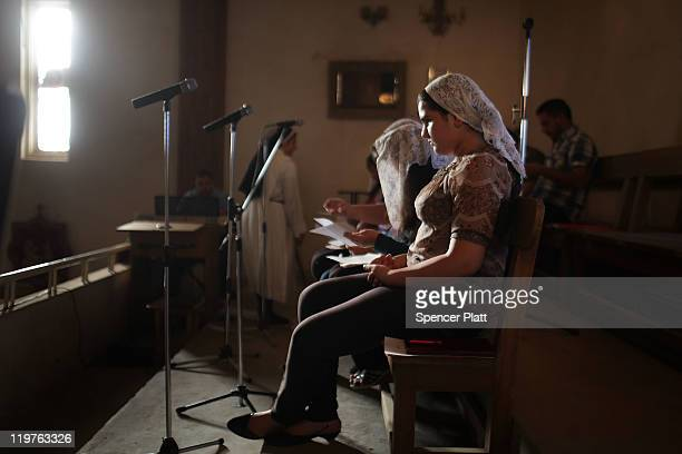 An Iraqi Christian choir group prepares to sing during a Sunday service at St Joseph Chaldean Church on July 24 2011 in Baghdad Iraq Forming one of...