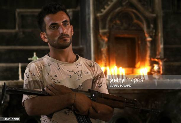 An Iraqi Christian forces member stands in the Church of the Immaculate Conception on October 30 2016 in the town of Qaraqosh 30 kms east of Mosul...