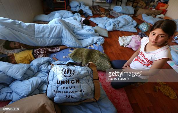 ASSIR An Iraqi Christian girl who fled with her family the violence in Iraq's largest Christian town of Qaraqosh looks on in a room of Ainkawa's...