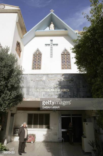 An Iraqi Christian man stands outside the Virgin Mary church in alKarrada central Baghdad 25 December 2007 Christians around the world celebrated...