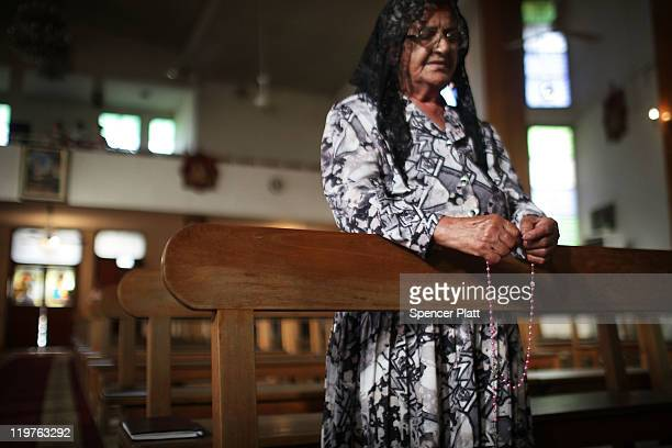 An Iraqi Christian woman prays at a Sunday service at St. Joseph Chaldean Church on July 24, 2011 in Baghdad, Iraq. Forming one of the oldest...