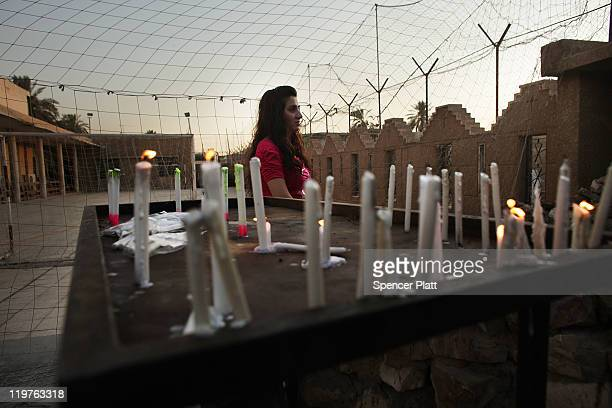 An Iraqi Christian woman prays outside of St. Joseph Chaldean Church on July 24, 2011 in Baghdad, Iraq. Forming one of the oldest Christian...