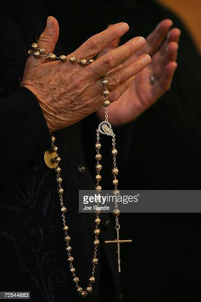 An Iraqi Christian women holds her rosary as she prays during mass February 9 2005 in Baghdad Iraq Christians are believed to make up just 3 percent...
