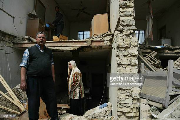 An Iraqi citizen stands outside of destroyed buildings in the Qadissiyah area March 23 2003 in Baghdad Iraq US aircraft carriers fired missiles into...