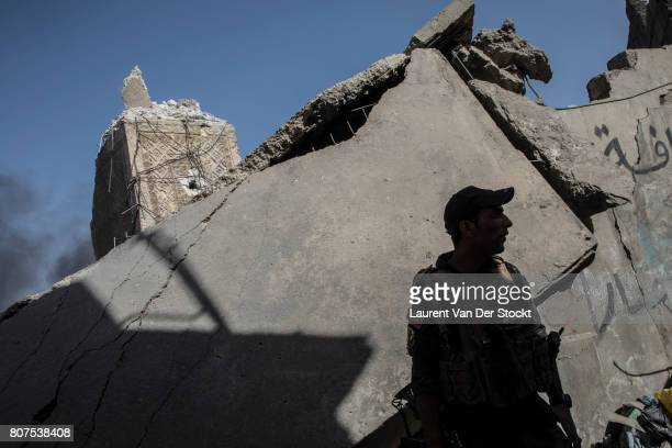 An Iraqi commando stands near the base of the ruined Hadba minaret in Mosul's alNuri mosque complex on June 29 2017 The Iraqi Army Special Operations...