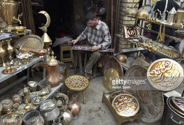 An Iraqi copper craftsman works at the copper market April 6 2006 in Baghdad Iraq According to the US Military Muhammed Hila Hammad Ubaydi a top aid...