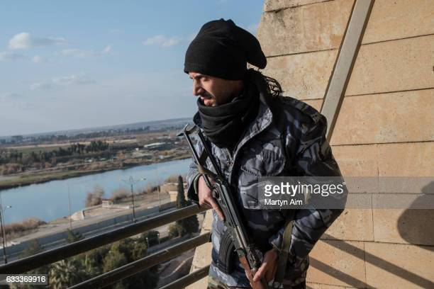 An Iraqi Counter Terrorism Service officer looks over the Tigris River at an Islamic State position from the Grand Mosul Hotel the largest and most...
