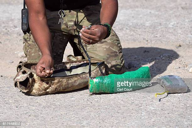 An Iraqi counter terrorism soldier makes safe a suicide bomb during the offensive to recapture the city of Mosul from Islamic State militants on...