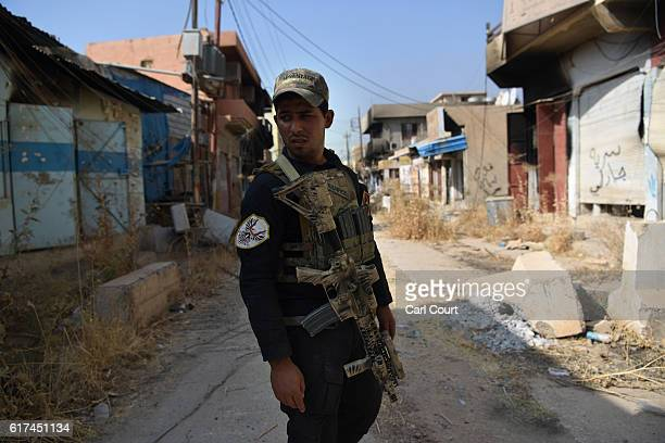 An Iraqi counter terrorism soldier stands in a partially destroyed street during the offensive to recapture the city of Mosul from Islamic State...