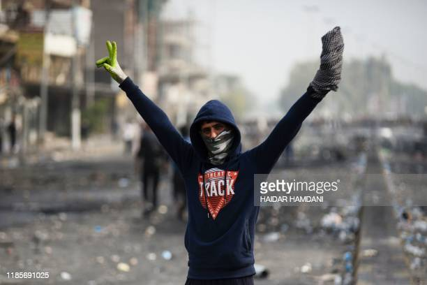 An Iraqi demonstrator gestures in the southern Iraqi Shiite holy city of Najaf on December 1 2019 Protesters have hit the streets since early October...