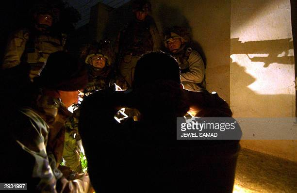 An Iraqi detainee is being questioning by US soldiers of the 1st Battalion, 22nd Infantry Regiment of the 4th Infantry Division during a raid in...