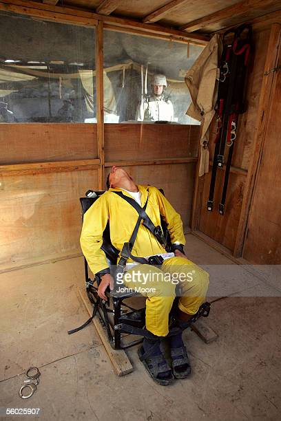 An Iraqi detainee screams Allah while tied down in a humane restraint chair at the maximum security section of the Abu Ghraib Prison October 28 2005...