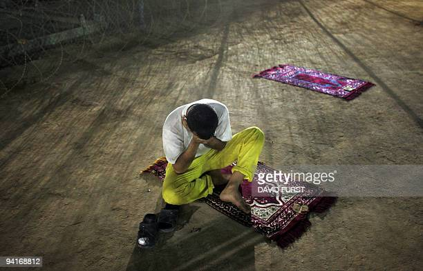 An Iraqi detainee sits outside a classroom inside the Camp Bucca detention centre located near the KuwaitIraq border on May 19 2008 There are...