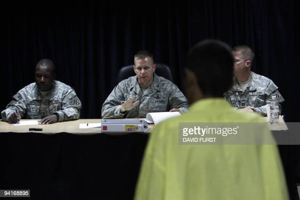An Iraqi detainee stands before a panel of US military personnel to discuss the circumstances of his detention at the Camp Bucca detention centre...