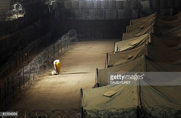 An Iraqi detainee washes his feet inside the Camp Bucca detention centre located near the KuwaitIraq border on May 19 2008 There are approximately...