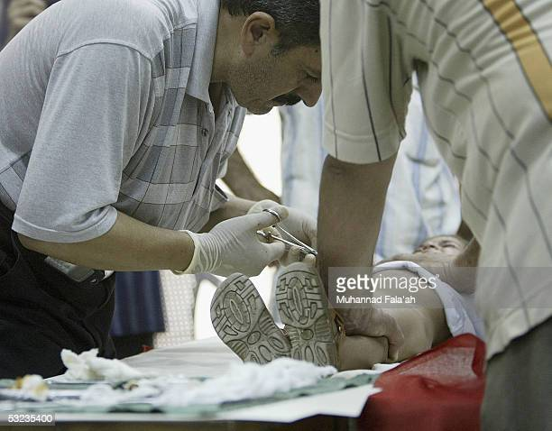 An Iraqi doctor circumcises a male child July 14 2005 in Baghdad Iraq Circumcision is a religious practice among Muslims and is seen as an act of...
