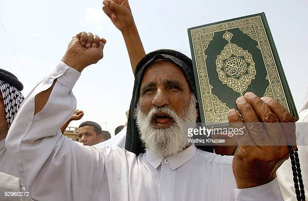 An Iraqi elderly man holds a copy of the Quran and chants anti American slogans as he protests the alleged desecration of the Quran May 20 2005 in...