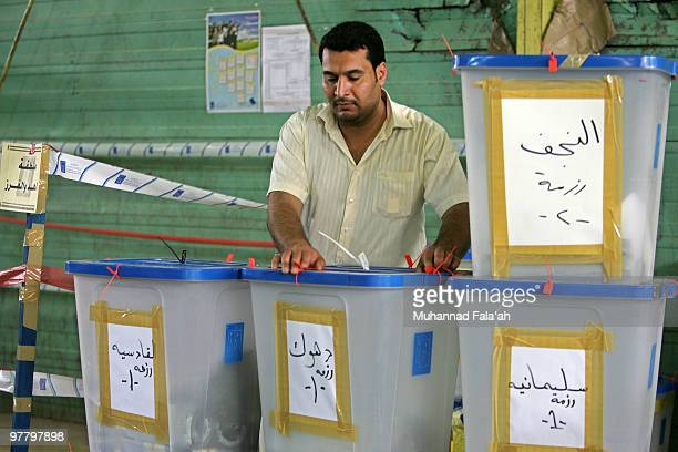 An Iraqi electoral worker carries a ballot box of Iraq�s Parliamentary elections on March 17 2010 at a counting center in Baghdad Iraq 79 percent of...
