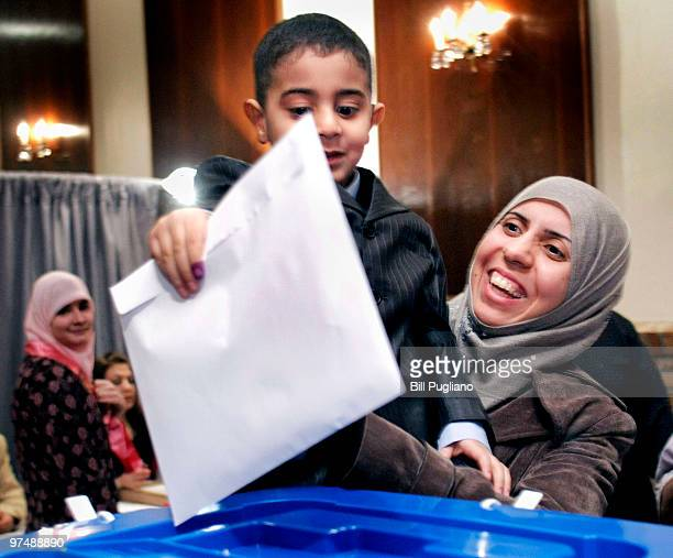 An Iraqi expatriate casts their ballot in the Iraqi parliamentary election at a polling station March 6 2010 in Dearborn Michigan The elections in...