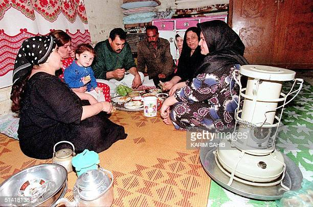 An Iraqi family breaks the first day of the holy Moslem month of Ramadan with an iftar meal at the end of the dwantodusk fasting in a Baghdad shelter...