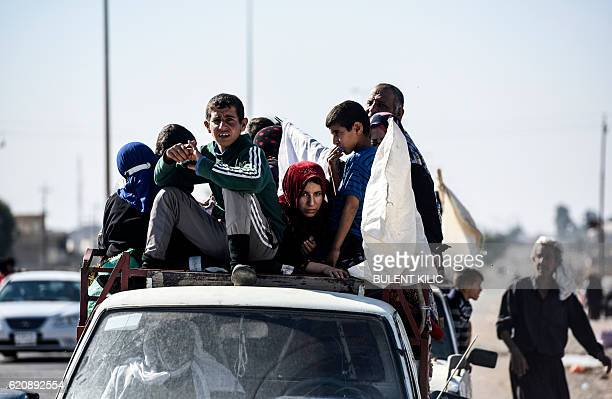 TOPSHOT An Iraqi family who fled the violence due to the ongoing operation by Iraqi forces against jihadists of the Islamic State group to retake the...