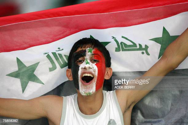 An Iraqi fan cheers for his team before the start of the final match of the Asian Football Cup 2007 between Iraq and Saudi Arabia at the Bung Karno...