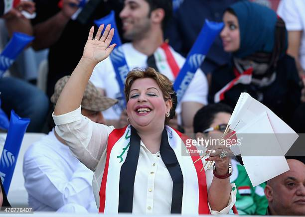 An Iraqi fan cheers her team on during the Asian Cup Qualification match between China and Iraq at the AlSharjah Stadium on March 5 2014 in Sharjah...