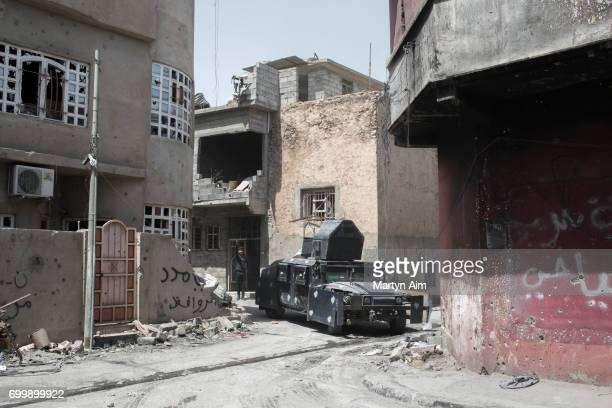 An Iraqi Federal Police humvee turns down a very narrow street on the frontline against Islamic State in Adedat a neighbourhood in the Old City of...