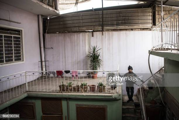 An Iraqi federal policeman waits in a house during the battle to recapture west Mosul from Islamic State, on April 13, 2017 in Mosul, Iraq. Despite...