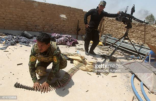 An Iraqi fighter from the Shiite popular mobilisation unit arranges a bullet belt in the outskirts of Baiji refinery north of Tikrit in the...