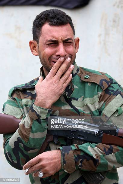 An Iraqi fighters mourns during the funeral procession of a comrade from the Hashed alShaabi paramilitaries who was killed in battles against Islamic...
