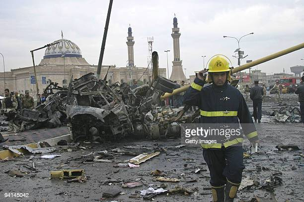 An Iraqi fireman surveys the damage at the site of a car bomb explosion on December 8 2009 in Baghdad Iraq A series of five bombings in Baghdad today...