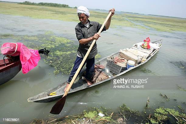 An Iraqi fisherman directs his dugout to shore on the alHuwaiza marshes northern Amara 420 km south of Baghdad on June 13 considered to be the...