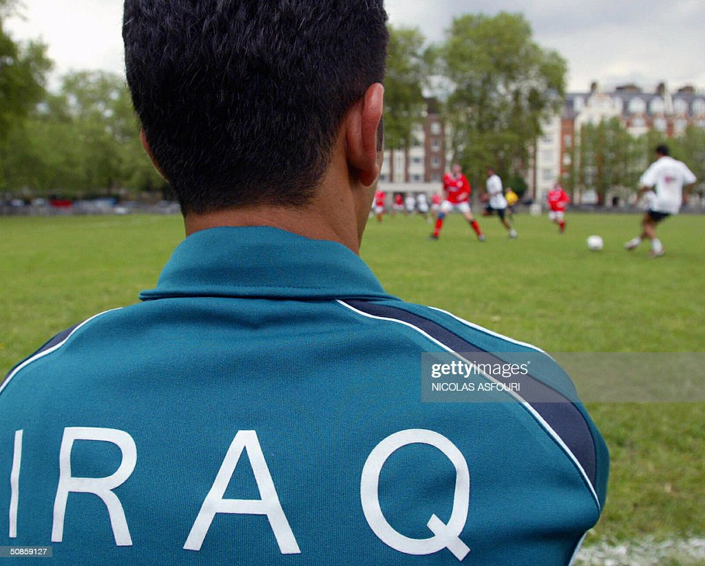 An Iraqi football player watches his team play against UK parliamentary football club in London, 20 May 2004. U.K parliamentary football club played against the national team of Iraq in a friendly match. Iraq won 11-0 over U.K parliamentary football club. AFP PHOTO Nicolas ASFOURI