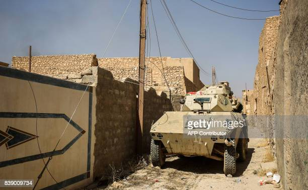 An Iraqi forces' armoured vehicle advances inside the town of Tal Afar west of Mosul after the Iraqi government announced the launch of the operation...