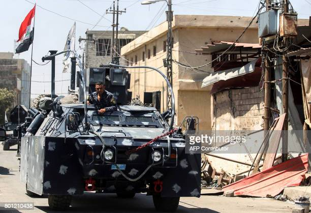 An Iraqi forces' armoured vehicle advances through the Old City of Mosul on June 26 as the offensive continues to retake the last district held by...