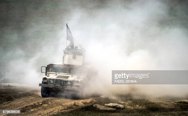 TOPSHOT An Iraqi forces' Emergency Response Division humvee advances on the frontlines in west Mosul on May 6 during the offensive to retake the area...