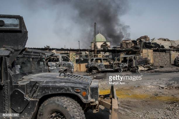 An Iraqi forces humvee in front of the destroyed alNuri mosque in the Old City of west Mosul where heavy fighting continues on June 30 2017 in Mosul...