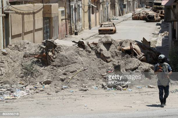 An Iraqi forces member monitors as they advance through the Old City of Mosul on June 24 2017 during the ongoing offensive to retake the last...