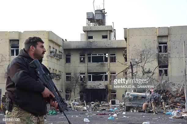 An Iraqi forces member patrols a street in Mosul next to AlSalam hospital in the alWihdah neighbourhood after recapturing the area from Islamic State...