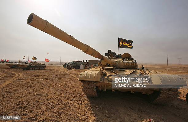TOPSHOT An Iraqi forces T72 tank is stationed near the village of Sin alDhuban south of Mosul on October 27 during an operation to retake the main...