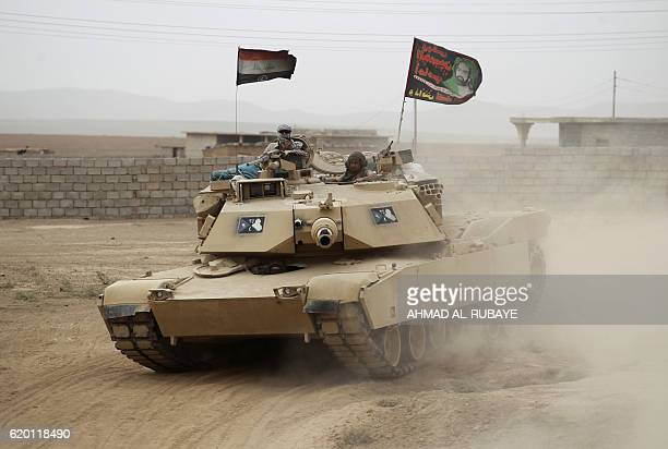 An Iraqi forces tank advances towards the village of Abu Shuwayhah south of jihadistheld Mosul on November 1 during the ongoing operation to retake...