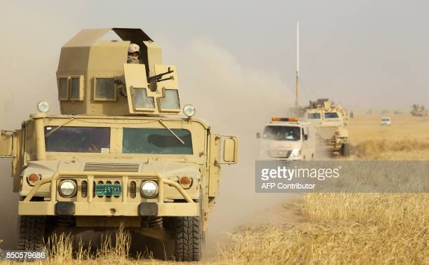 An Iraqi forces' USmade humvee advances in a convoy towards the city of alSharqat on September 21 where Iraqi forces backed by Hashed alShaabi...