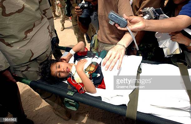 An Iraqi girl arrives at Camp Bucca to be reunited with her family after being treated for illness by the US military April 27 2003 in Umm Qasr Iraq...