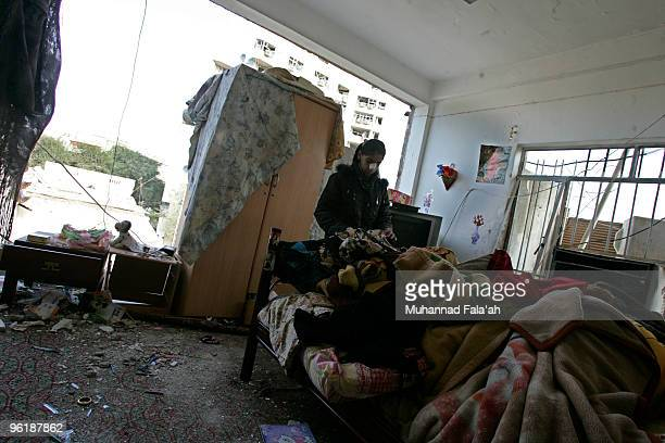 An Iraqi girl collects her belongings in her room which was damaged in yesterday's car bomb explosion near the AlHamra hotel on January 26 2010 in...