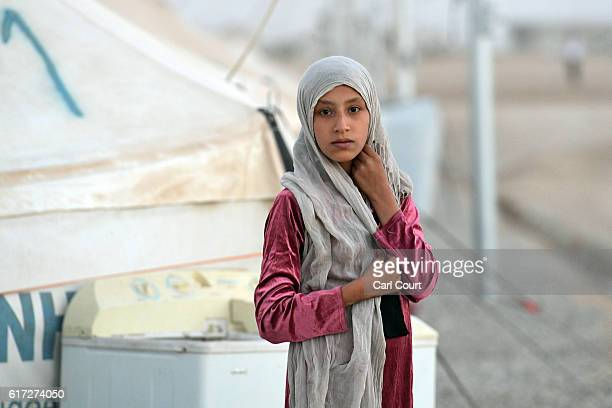 An Iraqi girl pauses in Debaga refugee camp where people displaced by fighting in and around Mosul have sought shelter on October 22 2016 in Debaga...