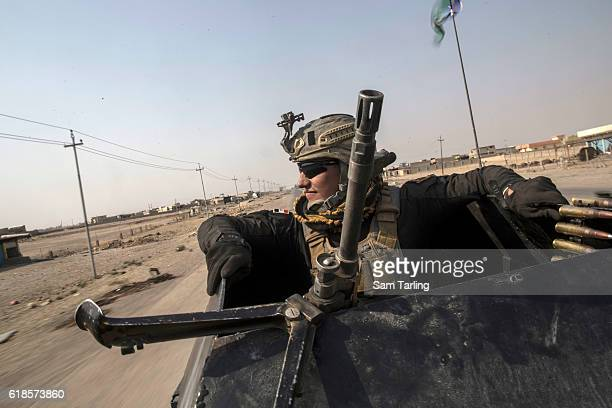 An Iraqi Golden Division soldier drives an armoured Humvee on October 27, 2016 in Bartella, Iraq. Bartella was recently captured from ISIS by Iraqi...